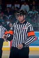 KELOWNA, CANADA - APRIL 18: Referee Reagan Vetter prepares to drop the puck between the # of the Kelowna Rockets and the Portland Winterhawks on April 18, 2014 during Game 1 of the third round of WHL Playoffs at Prospera Place in Kelowna, British Columbia, Canada.   (Photo by Marissa Baecker/Shoot the Breeze)  *** Local Caption *** Referee; Reagan Vetter;