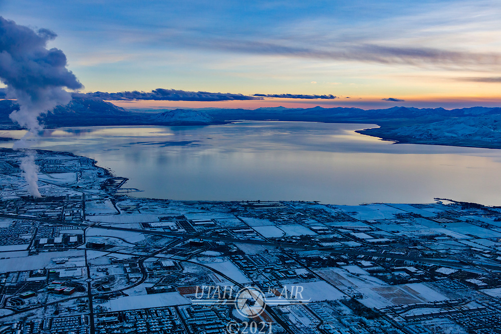 Sunset on Utah Lake in the winter with the steam cloud from the Lakeside power plant