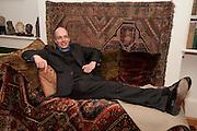 ALAIN DE BOTTON ON FREUD'S COUCH, Freud Museum dinner, Maresfield Gardens. 16 June 2011. <br /> <br />  , -DO NOT ARCHIVE-© Copyright Photograph by Dafydd Jones. 248 Clapham Rd. London SW9 0PZ. Tel 0207 820 0771. www.dafjones.com.
