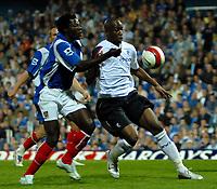 Photo: Ed Godden.<br /> Portsmouth v Bolton Wanderers. The Barclays Premiership. 25/09/2006. Portsmouth's Benjani (L) chases Bolton's Abdoulaye Melte.