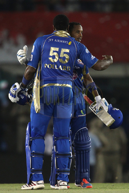Kieron Pollard of the Mumbai Indians and Lendl Simmons of the Mumbai Indians celebrate as Mumbai Indians beat Kings XI Punjab during match 48 of the Pepsi Indian Premier League Season 2014 between the Kings XI Punjab and the Mumbai Indians held at the Punjab Cricket Association Stadium, Mohali, India on the 21st May  2014<br /> <br /> Photo by Shaun Roy / IPL / SPORTZPICS<br /> <br /> <br /> <br /> Image use subject to terms and conditions which can be found here:  http://sportzpics.photoshelter.com/gallery/Pepsi-IPL-Image-terms-and-conditions/G00004VW1IVJ.gB0/C0000TScjhBM6ikg