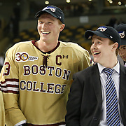 Patrick Brown #23 of the Boston College Eagles speaks with his teammates following The Beanpot Championship Game at TD Garden on February 10, 2014 in Boston, Massachusetts. (Photo by Elan Kawesch)