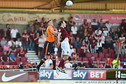 Oldham Athletic defender (on loan from Manchester City) Kean Bryan (34) heads the ball under pressure from Northampton Town midfielder John-Joe O'Toole (21) during the EFL Sky Bet League 1 match between Northampton Town and Oldham Athletic at Sixfields Stadium, Northampton, England on 5 May 2018. Picture by Dennis Goodwin.