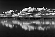 Clouds reflected in the Mackenzie River, Ft. Simpson, Northwest Territories, Canada<br />Fort Simpson<br />Northwest Territories<br />Canada