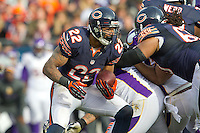 25 November 2012: Running back (22) Matt Forte of the Chicago Bears runs the ball against the Minnesota Vikings during the first half of the Bears 28-10 victory over the Vikings in an NFL football game at Soldier Field in Chicago, IL.