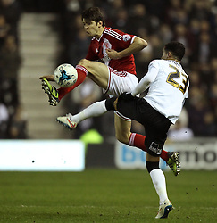 Middlesbrough's George Friend beats Derby County's Tom Ince to the ball - Photo mandatory by-line: Robbie Stephenson/JMP - Mobile: 07966 386802 - 17/03/2015 - SPORT - Football - Derby - iPro Stadium - Derby County v Middlesbrough - Sky Bet Championship