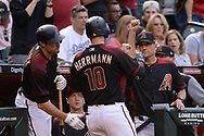 Apr 22, 2017; Phoenix, AZ, USA; Arizona Diamondbacks catcher Chris Herrmann (10) is congratulated by center fielder A.J. Pollock (11) and manager Torey Lovullo (17) after hitting two run homer in the fourth inning against the Los Angeles Dodgers at Chase Field. Mandatory Credit: Jennifer Stewart-USA TODAY Sports