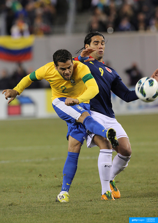 Dani Alves, Brazil, in action during the Brazil V Colombia International friendly football match at MetLife Stadium, New Jersey. USA. 14th November 2012. Photo Tim Clayton