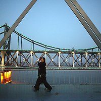 SHINIUJU, OCTOBER-26: people walk on the bridge that divides China and North Korea  in   Dandong,October 26,2006.