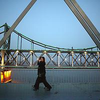 SHINIUJU, OCTOBER-26: people walk on the bridge that divides China and North Korea  in   Dandong,October 26,2006.