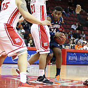 Rayvonte Rice #24 of the Illinois Fighting Illini muscles his way through  the Boston University Terriers defense during the NIT First Round game at Agganis Arena on March 19, 2014 in Boston, Massachusetts . (Photo by Elan Kawesch)