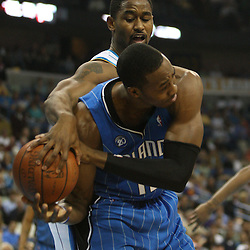 18 February 2009: New Orleans Hornets center Hilton Armstrong (12) strips the ball away from Orlando Magic center Dwight Howard (12) during a NBA basketball game between the Orlando Magic and the New Orleans Hornets at the New Orleans Arena in New Orleans, Louisiana.