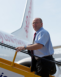 CARDIFF, WALES - Wednesday, September 1, 2010: Wales' Media Officer Karl Pedersen boards the plane at Cardiff Airport as the squad head out to Podgorica ahead of the opening UEFA Euro 2012 Qualifying Group 4 match against Montenegro. (Pic by David Rawcliffe/Propaganda)