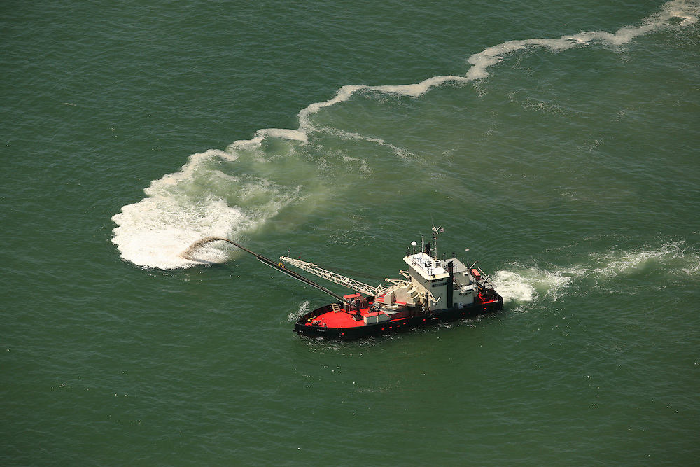Aerial image of Dredge boat pumping sand away from the Carolina Beach inlet.