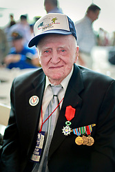 06 June 2014. The National WWII Museum, New Orleans, Lousiana. <br /> WWII veteran James Holdcraft, Electrician 2nd Class, US Navy is honored with the French Legion of Honor medal.<br /> Photo; Charlie Varley/varleypix.com