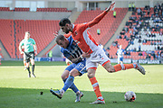 Lewis Alessandra (Hartlepool United) and Kelvin Mellor (Blackpool) fight for the ball during the EFL Sky Bet League 2 match between Blackpool and Hartlepool United at Bloomfield Road, Blackpool, England on 25 March 2017. Photo by Mark P Doherty.