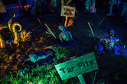 "Creatures struggle in tar pits in Chris Baker's haunted yard in South Yarmouth, MA. Every year Baker sets up an elaborate Halloween display in his yard and on Halloween, neighborohood residents walk through his frightening ""vortex"" of horror while trick or treating."