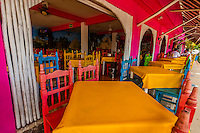 A colorful open air restaurant in the town of Tulum, Riviera Maya, Mexico.