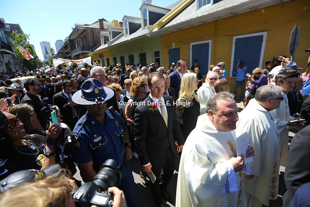 New Orleans Saints quarterback Drew Brees walks in a second line following the funeral service for NFL New Orleans Saints owner and NBA New Orleans Pelicans owner Tom Benson in New Orleans, Friday, March 23, 2018. Benson died last Thursday at the age of 90. (AP Photo/Derick Hingle)