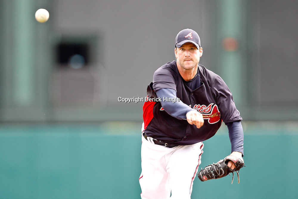 March 5, 2011; Lake Buena Vista, FL, USA; Atlanta Braves starting pitcher Derek Lowe (32) during a spring training exhibition game against the New York Mets at Disney Wide World of Sports complex.  Mandatory Credit: Derick E. Hingle