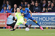 AFC Wimbledon striker Lyle Taylor (33) and Peterborough United defender Ryan Tafazolli (5) during the EFL Sky Bet League 1 match between AFC Wimbledon and Peterborough United at the Cherry Red Records Stadium, Kingston, England on 17 April 2017. Photo by Stuart Butcher.