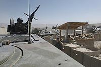 """11 AUG 2003, KABUL/AFGANISTAN:<br /> Transportpanzer """"Fuchs""""  mit Bewaffnung Maschinengewehr des deutschen Kontingents der International Security Assistance Force, ISAF, fahren  durch den schwer bewachten Eingang des Camp Warehouse, dem Lager der ISAF Truppen in der Naehe von Kabul<br /> IMAGE: 20030811-01-072<br /> KEYWORDS: Bundeswehr, Streitkraefte, Streitkräfte,  Logo, Schriftzug, sign, Bundeswehr, Panzer, MG, Tank"""