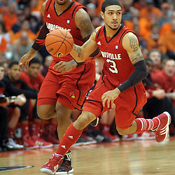 Louisville Cardinals guard Peyton Siva (3) runs the ball up court in the first half against the Syracuse Orange at the Carrier Dome in Syracuse, NY. Syracuse leads Louisville 26-19 at the half.