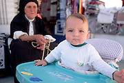 Baby with old woman, Olimbos, Karpathos, Greece