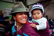 Quechuan Mother & Baby.Shopping For Hats At The Saquisili Market In Ecuador.