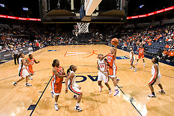 Clemson guard Morganne Campbell (32) shoots past Virginia center Aisha Mohammed (33).  The Virginia Cavaliers women's basketball team defeated the Clemson Tigers 83-71 at the John Paul Jones Arena in Charlottesville, VA on February 21, 2008.
