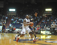 """Ole Miss guard Dundrecous Nelson (5)  dribbles past Alcorn State's Tony Eakles (30) at the C.M. """"Tad"""" Smith Coliseum in Oxford, Miss. on Thursday, December 29, 2010. Ole Miss won 100-62. (AP Photo/Oxford Eagle, Bruce Newman)"""