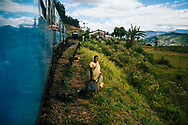 Lone Sri Lankan traveler waits along train tracks, Ella, Sri Lanka, Asia