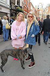 Left to right, COUNTESS ALEXANDRA TOLSTOY-MILOSLAVSKY and PHILIPPA HOLLAND and her dog Alfie at a private view of work & workings of Nic Fiddian Green - The Studio held at Sladmore Contemporary, 32 Bruton Place, London on 9th June 2015.