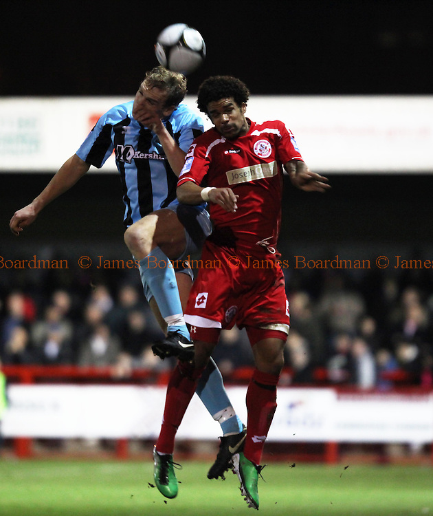 JAMES BOARDMAN / 07967642437.Crawley's Dean Howell and Daniel Wright [L] compete for the ball during the Blue Square Premier match between Crawley Town and Cambridge United at the Broadfield Stadium in Crawley January 25, 2011.