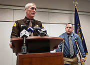 Major Mike Radich, left, speaks out advising motorists to slow down on the highways during a press conference at the Orem UHP Field Office, Monday, Dec. 31, 2012. Trooper B.J. Shelby, right, was struck and injured by another motorist while assisting at a crash scene on Christmas Eve.