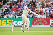 David Warner hits it skyward to be caught by Stuart Broad during 2nd day of the Investec Ashes Test match between England and Australia at Trent Bridge, Nottingham, United Kingdom on 7 August 2015. Photo by Shane Healey.