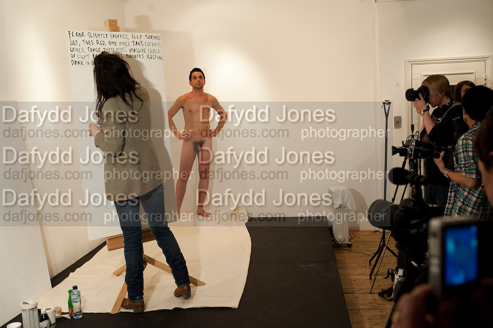 Fiona Banner; David Sallis,  'drawing' ; Live performance at the Party to celebrate the Other Criteria publication of; Fiona Banner.Performance Nude. Charing Cross Rd. London. 24 March 2010