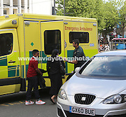 A woman and young boy are led to an ambulance after emerging from the Post Office after the raid - Immediate aftermath of armed raid on Post Office in George Street, Coydon<br /> <br />  - &copy; David Young - www.davidyoungphoto.co.uk - email: davidyoungphoto@gmail.com