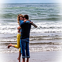 Young lovers embracing at the beach.