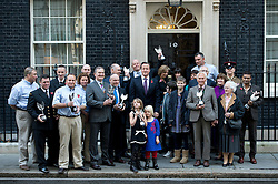 © London News Pictures. 30/10/2012. London, UK.  British Prime Minister David Cameron during a photo call with the winners of the Pride of Britain awards in front of 10 Downing Street on October 30, 2012.  Photo credit: Ben Cawthra/LNP