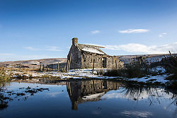 © Licensed to London News Pictures. 10/11/2016. Ingleton UK. Picture shows a derelict farm building still surrounded by snow in the Yorkshire Dales. Photo credit: Andrew McCaren/LNP