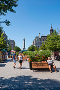 Tourists enjoy a beautiful summer day on Place Jacque Cartier, Montreal, Quebec, Canada.