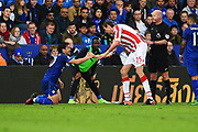 Stoke City striker Peter Crouch (25) up after fouling Leicester City forward Shinji Okazaki (20) during the Premier League match between Leicester City and Stoke City at the King Power Stadium, Leicester, England on 1 April 2017. Photo by Jon Hobley.