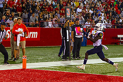 NORMAL, IL - September 21: Joe Logan bobbles a pass several times before controlling the reception in the end zone under the watchful eye of line judge Marc Shield during a college football game between the ISU (Illinois State University) Redbirds and the Northern Arizona University (NAU) Lumberjacks on September 21 2019 at Hancock Stadium in Normal, IL. (Photo by Alan Look)
