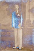 emulsion silver mirroring studio portrait of an teenager boy standing