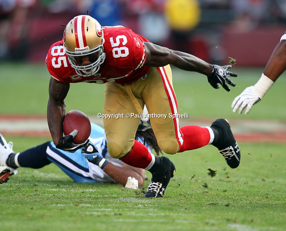 San Francisco 49ers tight end Vernon Davis (85) breaks a tackle for some extra yardage during the NFL football game against the Tennessee Titans, November 8, 2009 in San Francisco, California. The Titans won the game 34-27. (©Paul Anthony Spinelli)