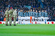 Leeds United players observe a minute silence during the EFL Sky Bet Championship match between Leeds United and Blackburn Rovers at Elland Road, Leeds, England on 9 November 2019.