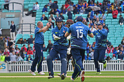 Sam Billings (Kent) congratulates James Tredwell (Kent) on catching Rory Burns (Surrey) during the Royal London 1 Day Cup match between Surrey County Cricket Club and Kent County Cricket Club at the Kia Oval, Kennington, United Kingdom on 12 May 2017. Photo by Jon Bromley.