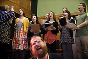 Sanderson Jones (front) is dancing to uplifting music while the choir is singing on stage during The Sunday Assembly (today held inside Conway Hall in central London), an atheist service founded by British comedians Sanderson Jones and Pippa Evans in 2013, in London, England. The gathering is designed to bring together non-religious people who want a similar communal experience to a religious church. Satellite assemblies have been established in over 30 cities including New York, San Diego, and Dublin.