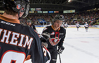 KELOWNA, CANADA - FEBRUARY 28: Jake Virtanen #18 of Calgary Hitmen celebrates a second period goal against the Kelowna Rockets on February 28, 2015 at Prospera Place in Kelowna, British Columbia, Canada.  (Photo by Marissa Baecker/Shoot the Breeze)  *** Local Caption *** Jake Virtanen;